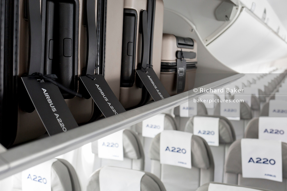 Overhead locker baggage space of the Airbus A220-300 being demionstrated at the Farnborough Airshow, on 18th July 2018, in Farnborough, England.