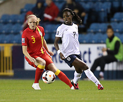England's Eniola Aluko (Chelsea) vies for possession with Wales's Helen Bleazard - Chelsea - Photo mandatory by-line: Robin White/JMP - Tel: Mobile: 07966 386802 26/10/2013 - SPORT - FOOTBALL - The Den - Millwall - England Women v Wales Women - World Cup Qualifier - Group 6