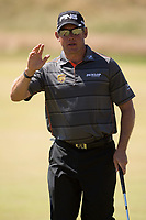 Golf - 2013 Open Championship at Muirfield - Friday Round Two<br /> Lee Westwood of England waves in appreciation as the crowd applause his putting on the 17th