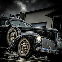 Classic car from the 1960's in rain