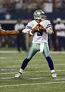 Dallas Cowboys quarterback Tony Romo (9) avoids the outstretched hand of a defender as he throws a first quarter pass good for a first down on the first drive during the NFL week 6 football game against the Washington Redskins on Sunday, Oct. 13, 2013 in Arlington, Texas. The Cowboys won the game 31-16. ©Paul Anthony Spinelli