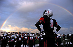 Underneath a rainbow, Dawson's Mykul Mitchell watches the action from the sideline during the first half of a high school football game against George Ranch, Friday, August 29, 2014, at The Rig in Pearland, TX. (Photo: Eric Christian Smith/For the Houston Chronicle)