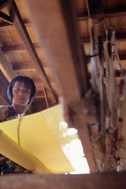 Weaver at loom, Silk factory at Inpaw Khone Village, Inle Lake, Shan State, Myanmar