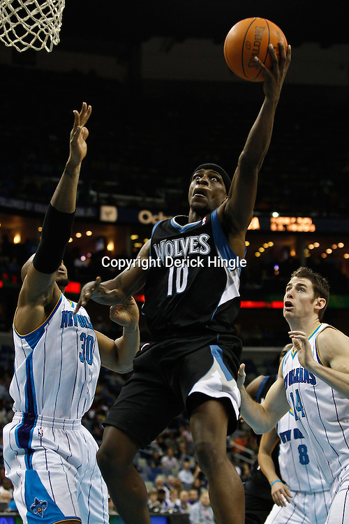 February 7, 2011; New Orleans, LA, USA; Minnesota Timberwolves point guard Jonny Flynn (10) shoots over New Orleans Hornets power forward David West (30) and power forward Jason Smith (14)during the fourth quarter at the New Orleans Arena. The Timberwolves defeated the Hornets 104-92.  Mandatory Credit: Derick E. Hingle