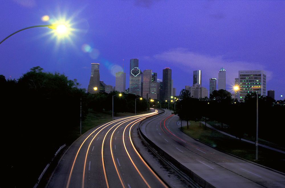 Houston, Texas skyline with motion blur of vehicle lights at night.