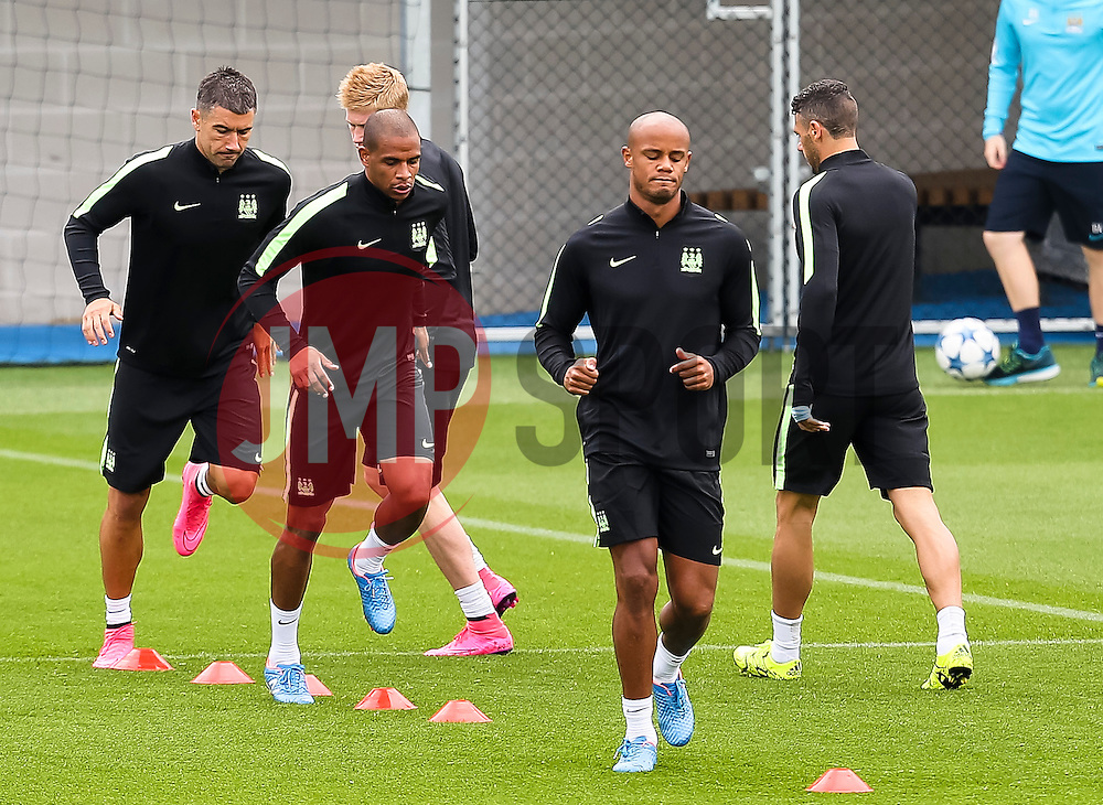 Manchester City captain, Vincent Company, Fernando and Aleksander Kolarov during the training session at the Etihad Stadium ahead of the UEFA Champions League group D match against Juventus - Mandatory byline: Matt McNulty/JMP - 07966386802 - 14/09/2015 - FOOTBALL - Etihad Stadium -Manchester,England - UEFA Champions League