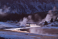 Scenic winter image of Old Faithful basin and Firehole River in Yellowstone National Park, WY.