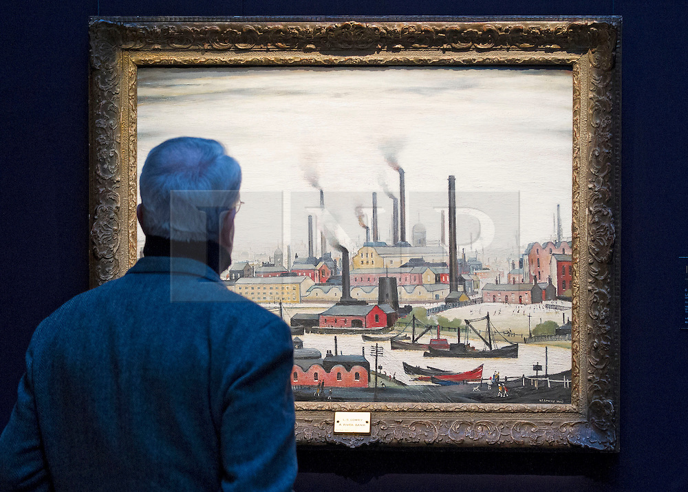 "© Licensed to London News Pictures. 21/03/2014. London, UK. A visitor to Sotheby's auction house views ""A River Bank"" (1947) (est. GB£1.500,000-2,500,000) by British artist LS Lowry during the press view for a new sale of the artist's work in London today (21/03/2014). The auction, entitled ""Lowry: The AJ Thompson Collection"", features works by Lowry assembled over a 30 year period by collector A.J. Thompson. Photo credit: Matt Cetti-Roberts/LNP"