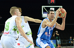 Edo Muric of Slovenia and Jaka Klobucar of Slovenia vs  Nikalaos Zisis of Greece during friendly match between National Teams of Slovenia and Greece before World Championship Spain 2014 on August 17, 2014 in Kaunas, Lithuania. Photo by Robertas Dackus / Sportida.com
