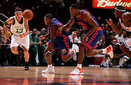 Delonte West (L) of the Boston Celtics and Nate Robinson Antonio Davis of the New York Knicks go for a loose ball at Madison Square Garden in New York City. Sunday 04 December 2005 The Knicks won the game 102-99 Photo by Andrew Gombert for the New York Times