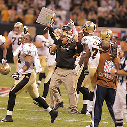 2008 September 7: New Orleans Saints Head Coach Sean Payton (center) celebrates after his defense stopped the Tampa Bay Buccaneers offense on fourth down late in the fourth quarter to secure the win for New Orleans in their home opener at the Louisiana Superdome in New Orleans, LA.  The New Orleans Saints (1-0) defeated the Tampa Bay Buccaneers (0-1) 24-20.