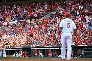 17 April 2010: Cardinal fans do the wave around Busch Stadium as St. Louis Cardinals first baseman Albert Pujols (5) steps into the box in the Cardinals game against the New York Mets at Busch Stadium in St. Louis, Missouri. The Game would go 20 innings, with the Mets winning 2-1..