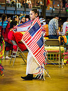 06 MAY 2017 - ST. PAUL, MN: A girl wearing an American flag shawl dances in an intertribal dance at the 6th Annual Powwow for Hope at Ft. Snelling in St. Paul. She said one of her uncles died from lymphoma he contracted from being around Agent Orange during the war in Vietnam. She said she wears red, white and blue in his honor. The powwow was a fundraiser to support cancer education and supportive services for American Indian communities. Proceeds benefited the American Indian Cancer Foundation's work to eliminate cancer burdens on American Indian families. Cancer is the leading cause of death in Native American communities, exceeding coronary disease and diabetes.       PHOTO BY JACK KURTZ