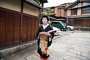 Geisha walking in the street in the old town district of Gion in Kyoto