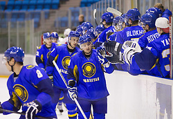 Players  of Kazakhstan celebrate during Friendly Ice-hockey match between National teams of Slovenia and Kazakhstan on April 9, 2013 in Ice Arena Tabor, Maribor, Slovenia.  (Photo By Vid Ponikvar / Sportida)