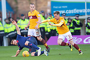 Oliver Bozanic (#7) of Heart of Midlothian tries to get to the ball ahead of Liam Grimshaw (#14) and Elliott Frear (#11) of Motherwell FC during the Ladbrokes Scottish Premiership match between Motherwell FC and Heart of Midlothian FC at Fir Park, Stadium, Motherwell, Scotland on 17 February 2019.