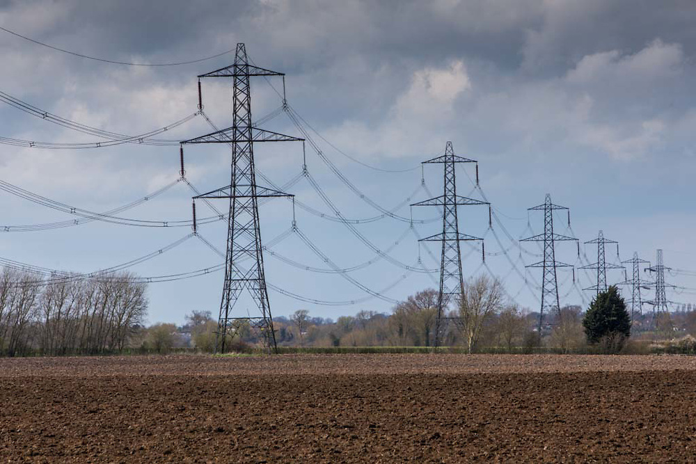 400 kV overhead electricity power lines suspended by pylons and used to transmit electric energy across large distances across Oxfordshire, United Kingdom.  (photo by Andrew Aitchison / In pictures via Getty Images)