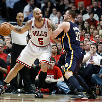 CHICAGO, IL - APR 18: Carlos Boozer #5 of the Chicago Bulls posts up Josh McRoberts #32 of the Indiana Pacers during game 2 of the Eastern Conference First Round at the United Center on April 18, 2011 in Chicago, IL. NOTE TO USER: User expressly acknowledges and agrees that, by downloading and or using this photograph, User is consenting to the terms and conditions of the Getty Images License Agreement. Mandatory Credit: 2011 NBAE (Photo by Chris Elise/NBAE via Getty Images)