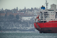 Ship in Commencement Bay, snow surrounding Stadium High School in the background - Tacoma, WA