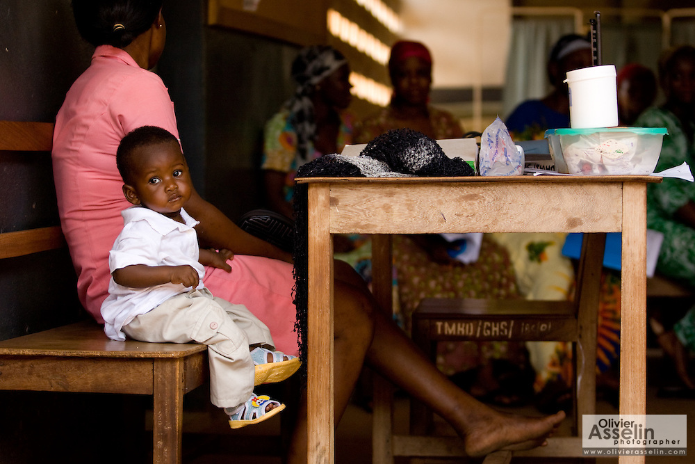A child sits on a bench at the Bilbela health centre in Bilbela, northern Ghana on Wednesday March 25, 2009.