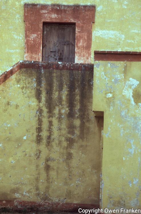 Pastel walls in Oaxaca, Mexico - photograph by Owen Franken