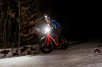 Hugh Ruthuen heads down Broadhead to Longbow during loop 1 of the Fatbike Fury night race at Gunstock Nordic on Saturday evening.  (Karen Bobotas/for the Laconia Daily Sun)