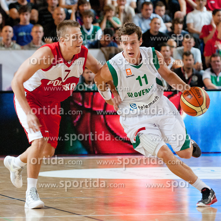 Tomasz Snieg of Poland vs Goran Dragic of Slovenia at exhibition game between Slovenia and Poland for Primus Trophy 2011Lithuania as part of exhibition games before European Championship L2011on July 23, 2011, in Ljudski Vrt, Ptuj, Slovenia. (Photo by Matic Klansek Velej / Sportida)