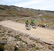 People cycling in Sierra Nevada Mountains, High Alpujarras, Granada Province, Spain