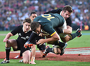 JOHANNESBURG, South Africa, 04 October 2014 : Richie McCaw (C) of the All Blacks tries to hold back Handré Pollard of the Springboks from the try line for his second try during the Castle Lager Rugby Championship test match between SOUTH AFRICA and NEW ZEALAND at ELLIS PARK in Johannesburg, South Africa on 04 October 2014. <br /> The Springboks won 27-25 but the All Blacks successfully defended the 2014 Championship trophy.<br /> <br /> © Anton de Villiers / SASPA