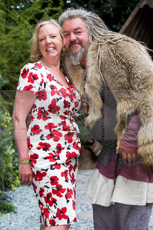 © Licensed to London News Pictures. 19/05/2014. London, England. Business woman Deborah Meaden (Dragon's Den) meets an actor portraying a Viking at the Viking Cruises Norse Garden. Press Day at the RHS Chelsea Flower Show. On Tuesday, 20 May 2014 the flower show will open its doors to the public.  Photo credit: Bettina Strenske/LNP