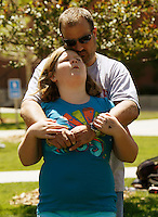 Jessie Matz, 11 is hugged by her father Tyler as they participated in group exercise in the 10-week Shapedown Program at The Children's Hospital in Aurora, Colorado May 29, 2010.  The program is part of the child and teen weight management program at the hospital. REUTERS/Rick Wilking (UNITED STATES)