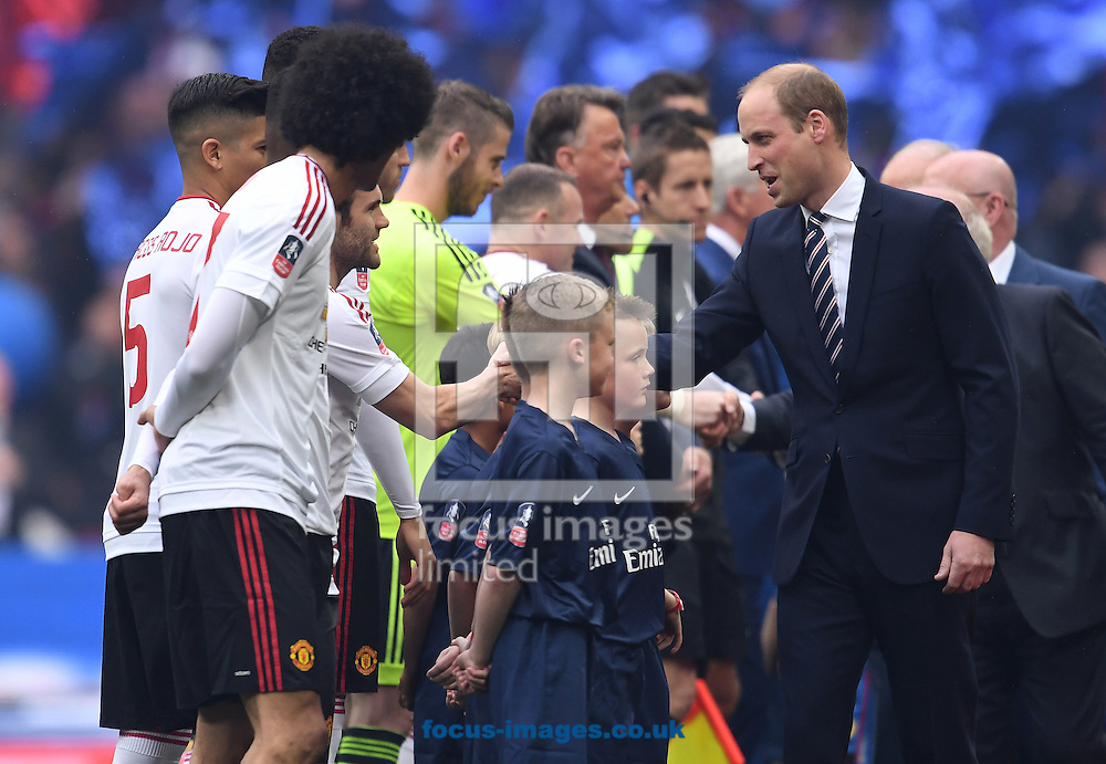 The Duke of Cambridge Prince William shakes hands with the teams before the FA Cup Final between Crystal Palace and Manchester United at Wembley Stadium, London<br /> Picture by Andrew Timms/Focus Images Ltd +44 7917 236526<br /> 21/05/2016