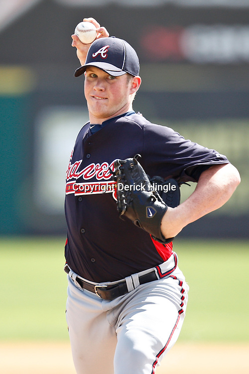March 4, 2011; Viera, FL, USA; Atlanta Braves relief pitcher Craig Kimbrel (46)during a spring training exhibition game against the Washington Nationals at Space Coast Stadium.  Mandatory Credit: Derick E. Hingle