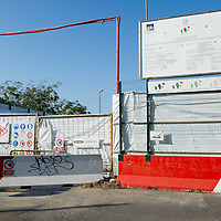VENICE, ITALY - AUGUST 18: Gates are closed at the building site for the New Palazzo del Cinema at Lido on August 18, 2011 in Venice, Italy. The works at the new Palazzo del Cinema have stalled after it emerged that more than 15m euros were necessary to remove asbestos from the structure.  (Photo by Marco Secchi/Getty Images)