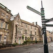 Street signs at one of the main intersections of the village of Painswick in the Cotswolds.