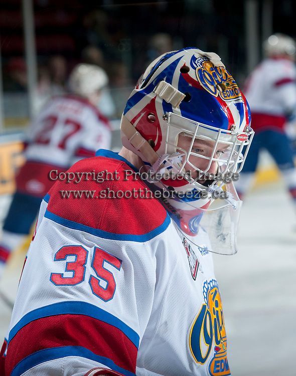 KELOWNA, CANADA - NOVEMBER 9: Tyler Santos #35 of the Edmonton Oil Kings stands on the ice against the Kelowna Rockets on November 9, 2013 at Prospera Place in Kelowna, British Columbia, Canada.   (Photo by Marissa Baecker/Shoot the Breeze)  ***  Local Caption  ***