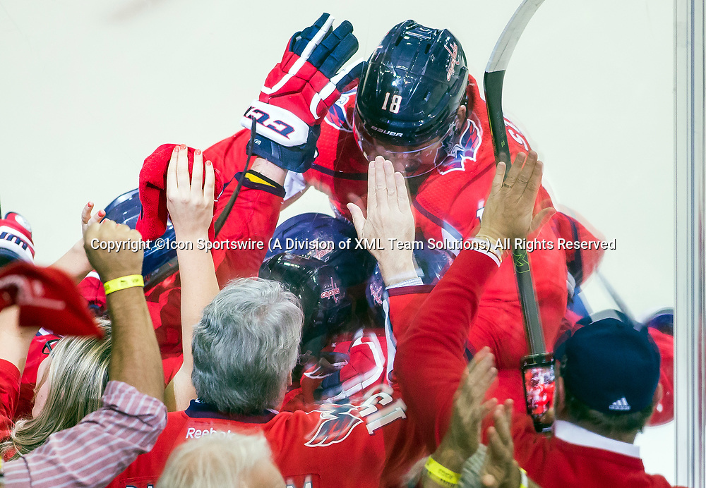 WASHINGTON, DC - MAY 21: Players surround Washington Capitals right wing Devante Smith-Pelly (25) after he had scored the second goal in the third period during game 6 of the NHL Eastern Conference  Finals between the Washington Capitals and the Tampa Bay Lightning, on May 21, 2018, at Capital One Arena, in Washington D.C. The Das defeated the Lightning 3-0<br /> (Photo by Tony Quinn/Icon Sportswire)
