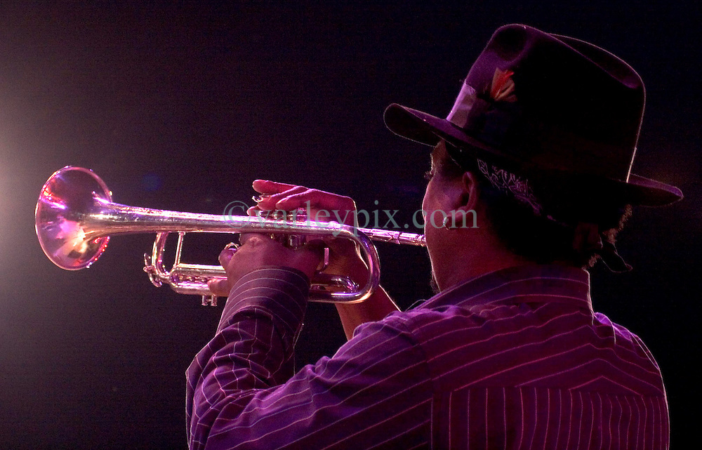 29 Oct, 2005.  New Orleans, Louisiana. Post Katrina.<br /> Let the good times roll. Back stage at Voodoo Fest tribute concert at Riverview Park. Kermit Ruffins returns to the stage and wows the crowd.<br /> Photo; &copy;Charlie Varley/varleypix.com