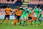 Barnet John Akinde (9) and Colchester Tom Eastman (18) battle from a Barnet corner  during the EFL Sky Bet League 2 match between Barnet and Colchester United at Underhill Stadium, London, England on 11 November 2017. Photo by Robin Pope.