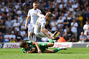 Preston North End midfielder Ben Pearson (4) does dangerous tackle on Leeds United midfileder Eunan O'Kane (14) during the EFL Sky Bet Championship match between Leeds United and Preston North End at Elland Road, Leeds, England on 12 August 2017. Photo by Ian Lyall.