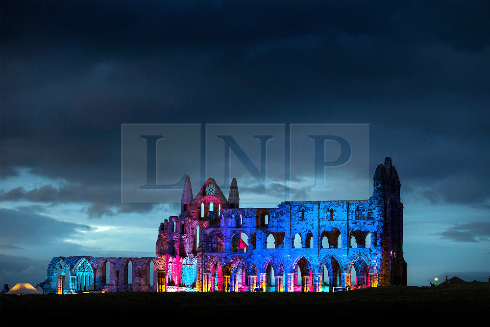 © Licensed to London News Pictures. 28/10/2016. Whitby UK. 13th century Whitby Abbey that inspired Bram Stocker's Dracula has had it's gothic architecture illuminated as part of Yorkshire Abbey season, a programme of special events celebrating some of Yorkshire's finest abbey's. Photo credit: Andrew McCaren/LNP