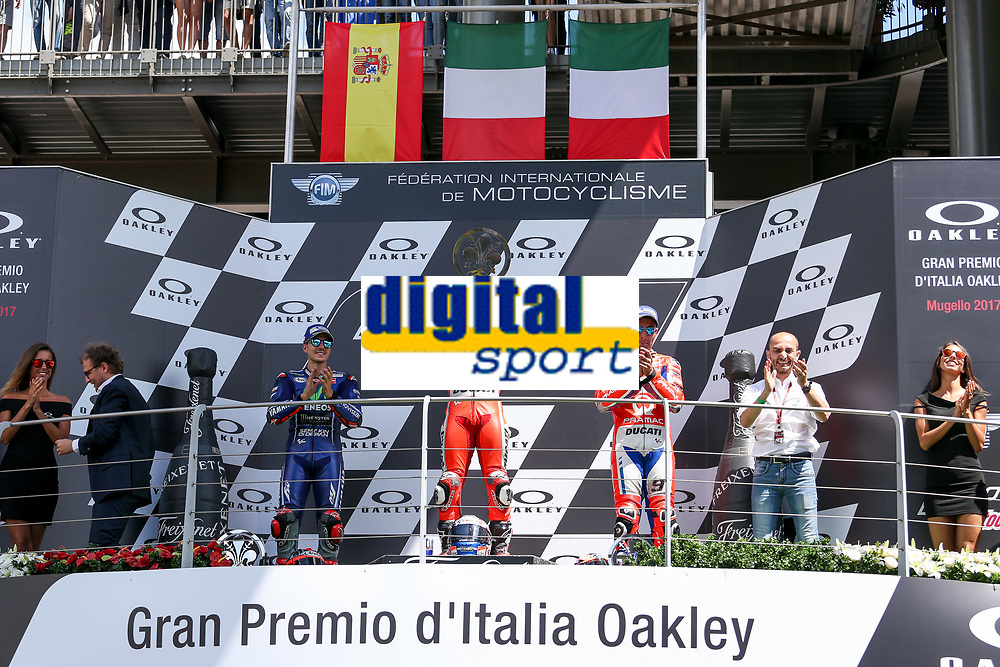 Ducati's Team rider Italian Andrea Dovizioso, winner, Maverick Vinales of Spain  and Movistar Yamaha MotoGP second, Danilo Petrucci of Italy and OCTO Pramac Racing third during the Moto GP Grand Prix at the Mugello race track on June 4, 2017 and Claudio Dominicali celebrates on the podium. <br /> MotoGP Italy Grand Prix 2017 at Autodromo del Mugello, Florence, Italy on 4th June 2017. <br /> Photo by Danilo D'Auria.<br /> <br /> Danilo D'Auria/UK Sports Pics Ltd/Alterphotos