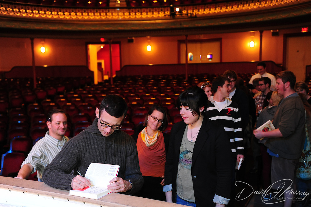 Author Chuck Palahniuk autographs books for Portsmouth-area high school writing students before an appearance at The Music Hall in Portsmouth, NH. Nov. 3, 2011