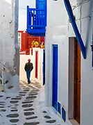 Alleyways of Mykonos - The warren of alleyways in Mykonos were thankfully empty of people at this time of year, until the person with just the right colour of hat happened to walk out of a shop at the end, and into the perfect position of my frame.<br /> <br /> f 18 @ 1/250 s, 500 ISO<br /> 14.0-24.0 mm f/2.8 at 24 mm on NIKON D850