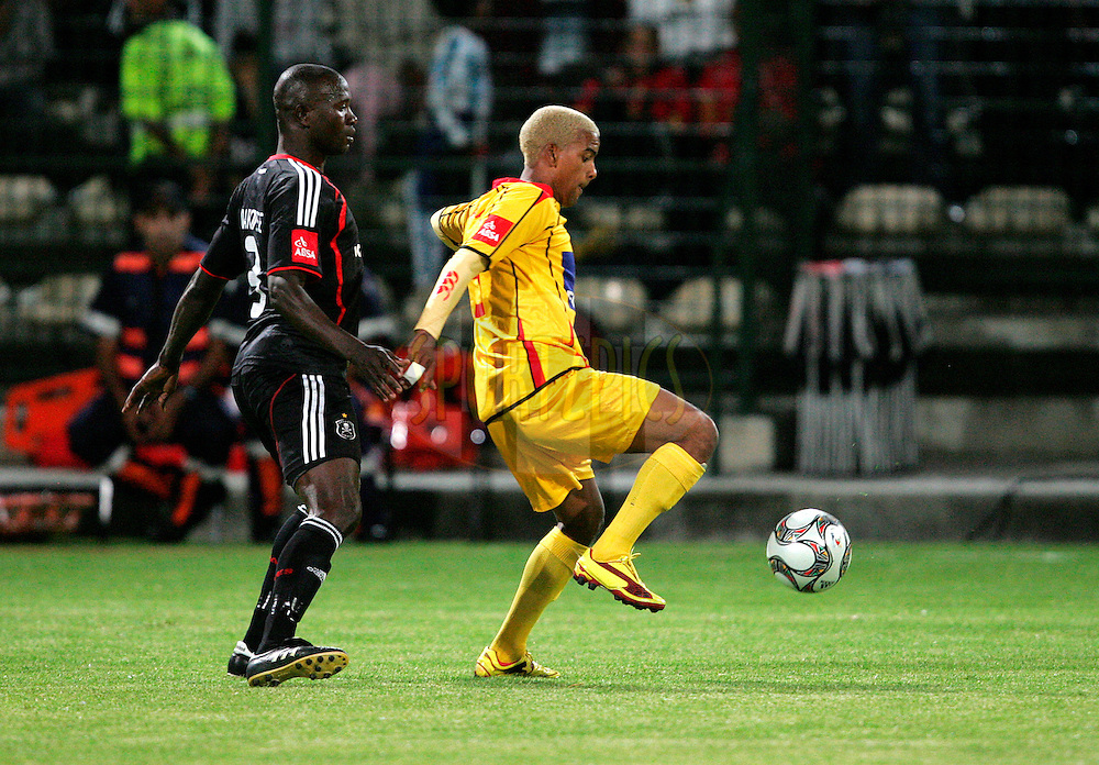 Makonese and Erwin Isaacs during the Absa Premiership , PSL, match between Santos and Orlando Pirates held at Athlone Stadium in Athlone, Cape Town, South Africa held on the 18 December 2009.Photo by: Ron Gaunt/sportzpics.net