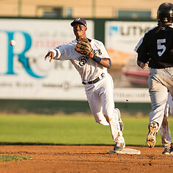 Luis Aviles (11) throws to first to complete the double play in the 4th inning, against the Grand Junction Rockies.