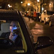 WASHINGTON, DC - APR 4:  UberX driver, Regan Rucker, calls a customer she is picking up, April 4, 2014, in Washington, DC. Rucker, a single mom who recently started driving for UberX, likes the flexibility of UberX because she can work whenever and however long she wants.<br /> <br /> Thousands of local car owners have signed up in recent months to drive with one of the &quot;ride-share&quot; operators that use smartphone apps to link people needing rides with car owners willing to give them, for a price. (Photo by Evelyn Hockstein/For The Washington Post)
