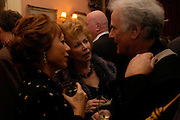 Kathy Lette and Edna O'Brien. Book party for 'Saturday' by Ian McEwan, Polish Club, South Kensington.  4 February 2005. ONE TIME USE ONLY - DO NOT ARCHIVE  © Copyright Photograph by Dafydd Jones 66 Stockwell Park Rd. London SW9 0DA Tel 020 7733 0108 www.dafjones.com