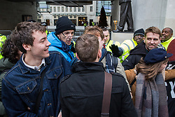 London, UK. 21st December, 2018. A member of staff tries to force his way through environmental campaigners from Extinction Rebellion protesting outside Broadcasting House against the lack of coverage by the BBC of the climate change crisis.