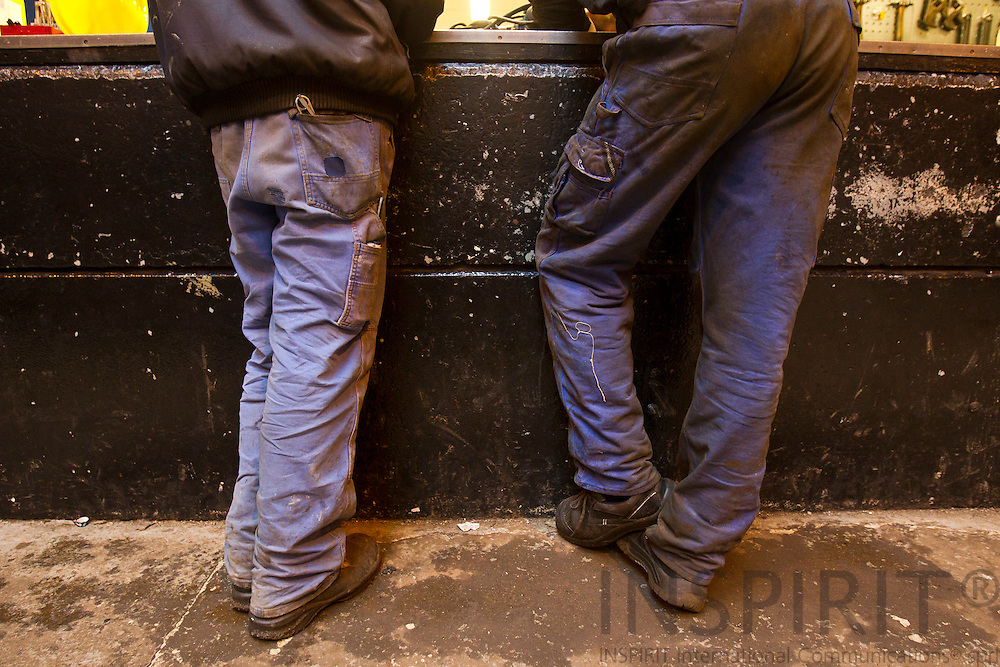 Two metal workers durty dress seen from behind at Soeby Ship Yard February 3, 2011.  Photo: Erik Luntang/INSPIRIT Photo